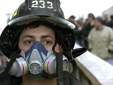 Feb 24 AP photo of firefighter wearing protective air mask